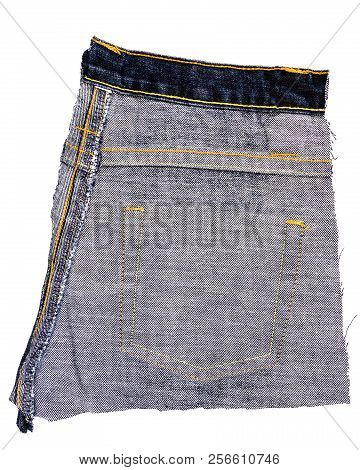 Piece Of Black Jeans Fabric Isolated On White Background. Rough Uneven Edges. Denim Jeans Torn. Wron