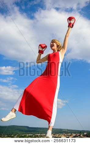 Satisfied Free Girl Boxing Gloves. Winner Concept. Femininity And Strength Balance. Woman Red Dress