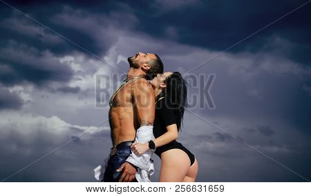 Concept of sensual and intimate moment of lovers. Feeling and emotion. Beautiful lady and guy with erotic pose. Romantic couple. Man enjoying foreplay with sexy lady. poster