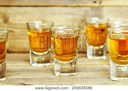 Closeup Of Whiskey Shots On Weathered Wooden Planks