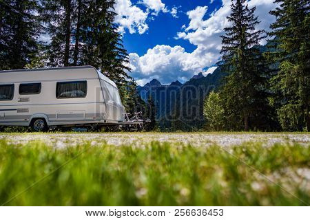 Family vacation travel, holiday trip in motorhome RV, Caravan car Vacation. Beautiful Nature Italy natural landscape Alps.