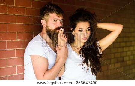 Break Or Pause For Smoking. Share Single Cigarette. Couple In Love Hugs While Smoking Cigarette Bric