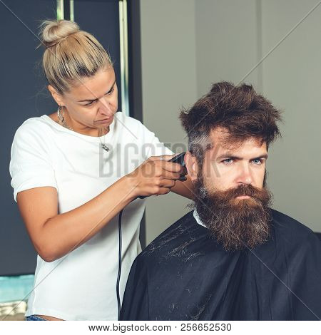 Master Cuts Hair And Beard Of Men, Beauteous Woman Hairdresser Makes Hairstyle For Man With Beard. H