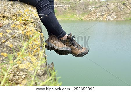 Walking Shoes. All Terrain Shoes. Hiking Shoes On Hiker Outdoors Walking Crossing River Creek. Woman