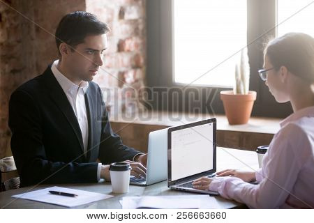 Serious Male And Female Looking At Each Other Struggling For Leadership