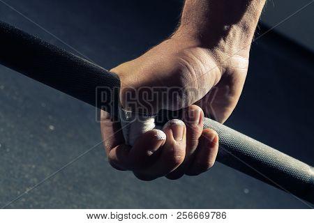 Closeup Of Man's Hand Gripping A Barbell