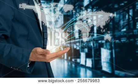 World Map On Hand Businessman With Modern Trade Warehouse Logistics, Uncle Plans To Invest In Transp