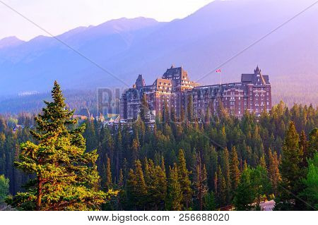 Sun Setting On Historic Banff Springs Hotel Nestled In The Canadian Rockies Of Banff National Park.