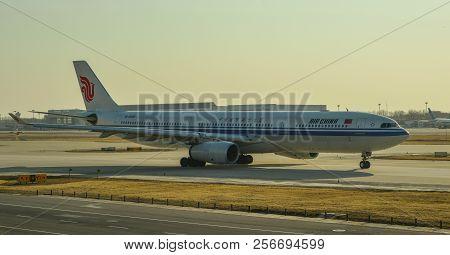 Passenger Airplane Docking At The Airport