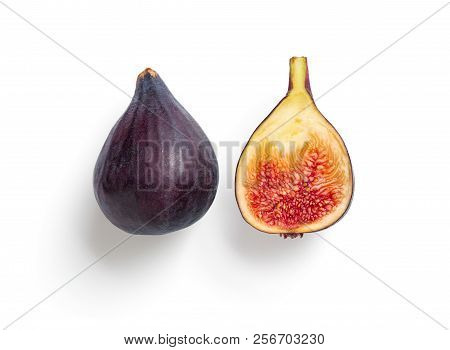 Creative Layout Made Of Figs. Half And Whole Fig Isolated On White With Clipping Path. Top View Of R