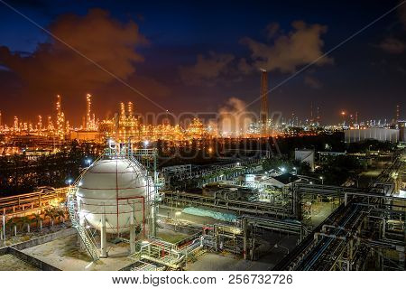 Gas Storage Sphere Tanks And Pipeline In Oil And Gas Refinery Industrial Plant With Glitter Lighting