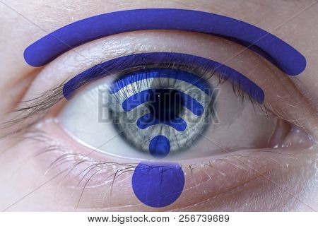 Human Face Painted With Wifi Symbol On The Face And The Iris.