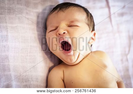 Funny Newborn Baby Girl Yawning With A Trace Of Mother Milk On Her Lips. Breast Feeding Baby Concept