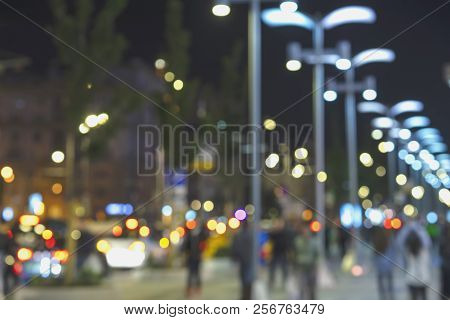 Abstract City Street In Evening, Unidentified People, Defocused Motion, Blurred Background.vivid Ill