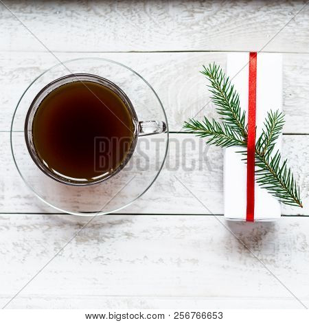 A Cup Of Black Coffee And A Giftbox Decorated With A Green Fir Tree Brabch On A White Wooden Tray. B