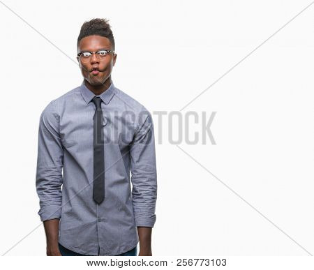 Young african american business man over isolated background making fish face with lips, crazy and comical gesture. Funny expression.