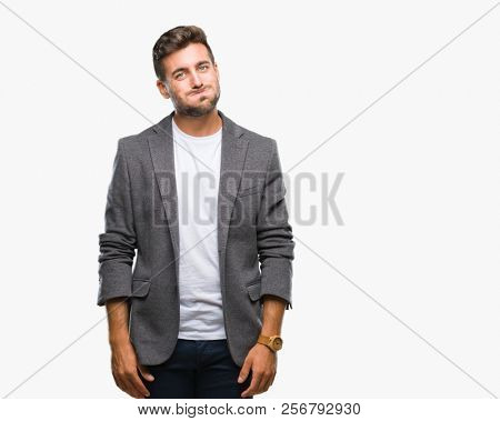Young handsome business man over isolated background puffing cheeks with funny face. Mouth inflated with air, crazy expression.