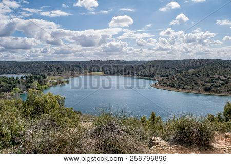 Landscape With A Lake And Cloudy Sky. Natural Park Lagunas De Rudiera. Spain.