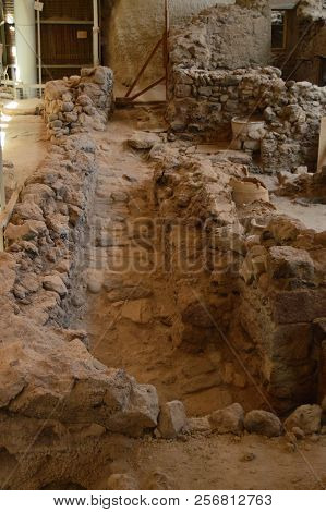 Path That Leads To A  Set Of Houses Very Well Preserved In The Archaeological Site Of Acrotiri. Arch