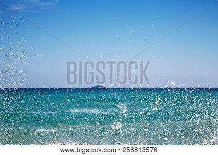 Pebble Beach And Blue Sky On Background
