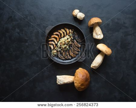 Cooking Penny Bun. Fried Cepes In A Iron Pan On The Black Table.