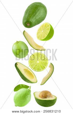 Falling Avocado And Lime Isolated On White Background