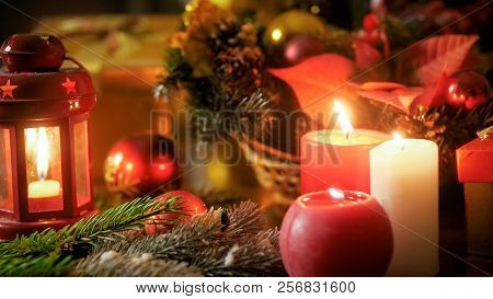 Closeup Image Of Burning Candles And Christmas Decorations On Wooden Table. Perfect Backgorund For W