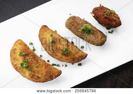 Portuguese Traditional Mixed Fried Tapas Snacks On Plate With Shrimp Rissole, Beef Croquette And Cod