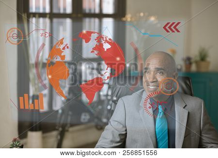 Smiling Professional Reading A Futuristic Screen In Front Of Him
