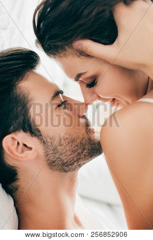 Close-up View Of Sensual Young Couple Able To Kiss In Foreplay