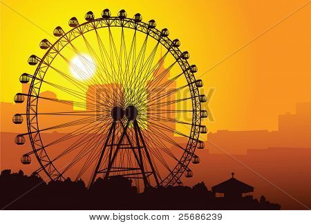 Silhouette of a ferris wheel at sunset