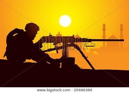 Gunner. Silhouette of a soldier with a machine gun