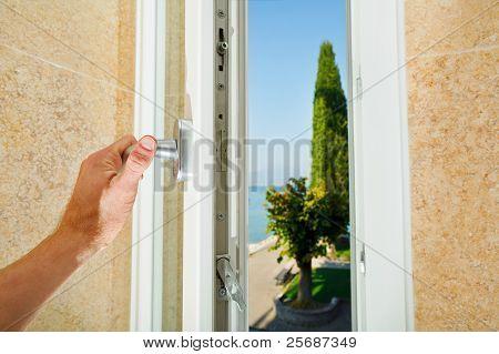 Hand Opening The Window