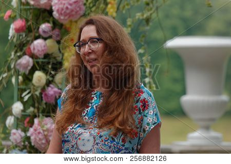 ST. PETERSBURG, RUSSIA - JULY 20, 2018: Saint-Petersburg florist Mila Schumann on the press opening of the festival Imperial Bouquet in the park of State Museum Pavlovsk