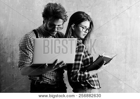 Pretty Girl Or Beautiful Woman With Notebook And Handsome Man With Laptop, Computer, In Checkered Sh