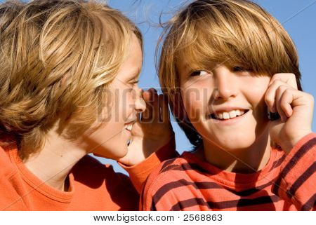 Happy Children Talking On Cell Phone