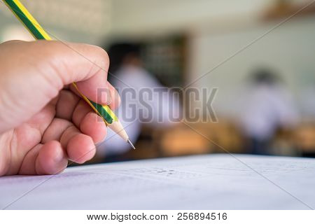 Students Hands Taking Exams, Writing Examination Room With Holding Pencil On Optical Form Of Standar