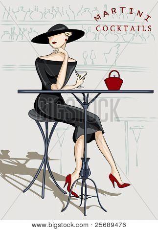 Schöne stilvolle Frau sitzt in einer cocktail bar