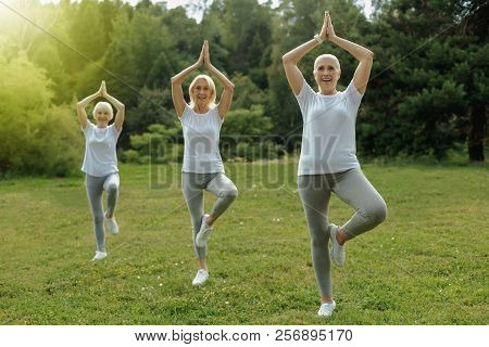 Fit Retied Ladies Taking Part In Yoga Class