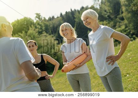 Relaxed Elderly Woman Joking After Exercising Outdoors