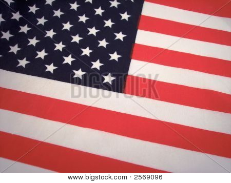 A close up of the stars and strips on an American flag poster