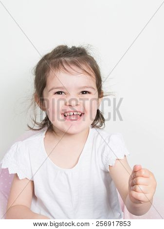 Cheerful Cute Child Kid Girl Smile Happy In White Clothes And Background
