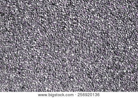 Small Sand Stone Of Sand Wall Texture Or Sand Wall Background. Natural Purple Sand Stone For Design