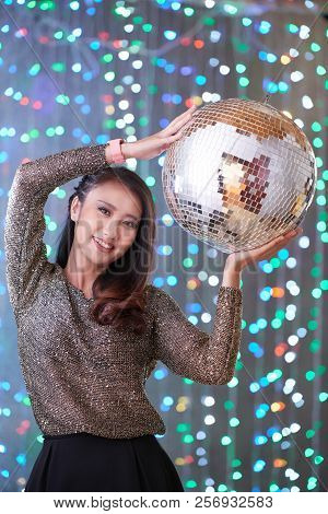 Beautiful Lovely Young Asian Woman Posing With Silver Discoball