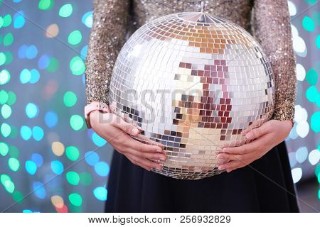 Discoball In Hands Of Young Woman Celebrating Birthday In Night Club