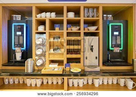 MOSCOW, RUSSIA - CIRCA AUGUST, 2018: coffee machine at Holiday Inn Express Hotel. Holiday Inn Express is a mid-priced hotel chain within the InterContinental Hotels Group family of brands.
