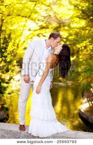 couple kissing in honeymoon outdoor autumn park