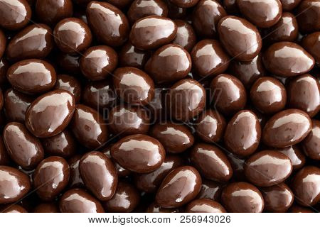 Macro Background Texture Of Dark Chocolate Covered Almonds In A Full Frame View In A Diet And Nutrit