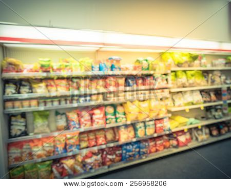 Blurry Background Snacks And Canned Chips At Pharmacy Store In America