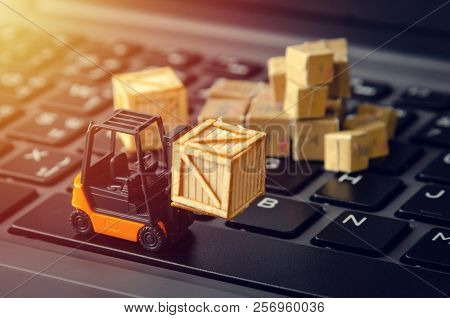 Forklift Freight Car Truck Loading Goods Product Wooden Boxes And Parcel On Laptop Computer Keyboard
